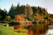 Fall Season Start Idyllic Lake Reflections Of Fall Foliage. Colorful Autumn Foliage Casts Its Reflec poster