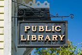 Weathered Hanging Public Library Sign poster