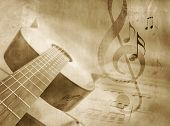 Grunge music background with guitar, sheet music and notes - musical event template in vintage style