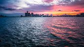 Sunset Over Detroit Michigan Skyline. Scenic Sunset Over The Downtown Waterfront Cityscape Of Detroi poster