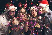 Friends Blowing Away Colorful Confetti poster