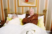 image of old couple  - Old couple in bed in a retro bedroom  - JPG