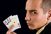 Young Lucky Gambler With Cards