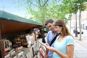 Couple in Paris looking at booksellers