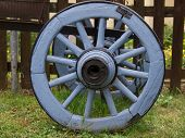 old blue wheel on the grass