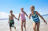 Fun Kids playing at the Beach