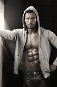 picture of stud  - Very sexy male model with open jacket revealing muscular body and nice abs and chest - JPG