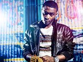 foto of swag  - Black youth with jacket and colorful lights - JPG