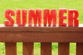 foto of watermelon  - Summer spelled in letters cut out of watermelon - JPG