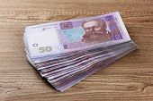 Ukrainian money on wooden background