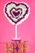 Decorative heart from paper on pink background