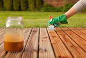image of household  - Painting wooden patio deck with protective varnish - JPG