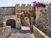 stock photo of turret arch  - Medieval defensive gate in the fortifications of Rhodes Old Town - JPG