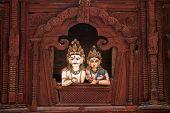 Shiva and Parvati wooden figures in the window of Shiva Parvati Hindu temple at Durbar Square in Kathmandu, Nepal