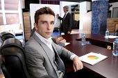 Portrait of  businessman in business training with his colleagues