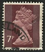 UK-CIRCA 1975:A stamp printed in UK shows image of Elizabeth II is the constitutional monarch of 16