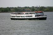 NEW YORK - MAY 17: A Circle Line boat cruise heads towards Manhattan on May 17, 2013 in New York.