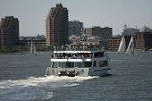 NEW YORK - MAY 17: Tourists enjoy a ride on the Zephyr Yacht Harbor Cruise on May 17, 2013 in New York.