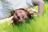 image of upside  - Portraits of happy kids playing upside down outdoors in summer park walking on hands - JPG