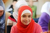 picture of muslimah  - Muslim and Arabic girls learning together in group - JPG
