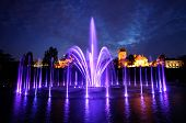 Illuminated Fountain At Night In Warsaw. Poland
