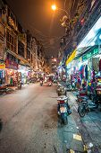 Street Life Of Hanoi At Night In Vietnam, Asia.