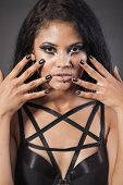Beautiful Woman Is Showing Nails. Fashion Portrait. Close-up Face Makeup