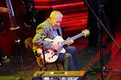 MOSCOW - NOVEMBER 15: Andrei Makarevich plays guitar at Brilliant Jazz Club concert in Izvestiya Hal
