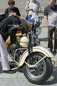 WROCLAW, POLAND - MAY 18: People are watching Harley Davidson motorcycle parked in the city during