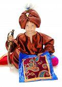 A boy dressed as a magician