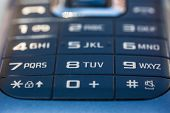 pic of dial pad  - macro shot of an obsolete and blue mobile phone keypad - JPG