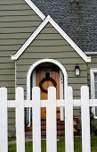 Cottage With Picket Fence