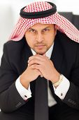 close up portrait of handsome arabian businessman sitting in office