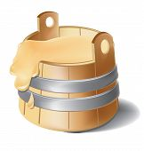 Wooden barrel of honey with metal silver clamps