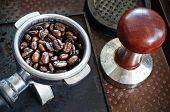 Espresso Filter Filled With Coffee Beans And Tamper