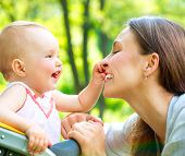 stock photo of mums  - Beautiful Mother And Baby outdoors - JPG