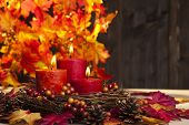 picture of auburn  - Candles in nice and beautiful colorful autumn leaves - JPG