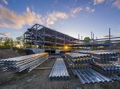 foto of scaffold  - Construction site at sunset with steel flooring in foreground - JPG