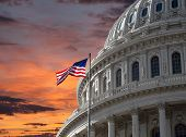 Sunset sky over the US Capitol building dome in Washington DC.