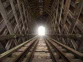 foto of covered bridge  - Light at the end of an old railroad covered bridge - JPG