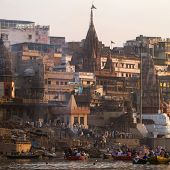 VARANASI, INDIA -23 MARCH: Manikarnika Ghat on the banks of Ganges river on March 23, 2013 in Varana