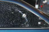 Bullet Holes In Car Window