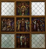 Stained Glass Window Picturing Jesus On The Cross.