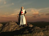 stock photo of templar  - Old Templar knight standing on a rock - JPG