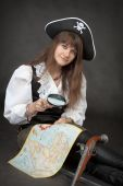 Pirate Girl With Sea Map Sit On A Black