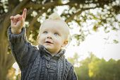 Adorable Little Blonde Baby Boy Outdoors at the Park.