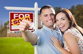 Mixed Race Excited Military Couple In Front of New Home with New House Keys and Sold Real Estate Sig