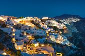 stock photo of breathtaking  - The beautiful Oia village on Santorini island at night - JPG