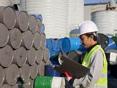 stock photo of bio-hazard  - Manufacture worker check the number of drums - JPG