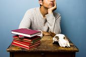 Man With Skull And Books Is Trying To Think